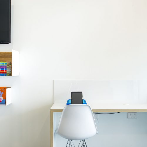 Our iPad station, selection of books and magazines and wall mounted tv